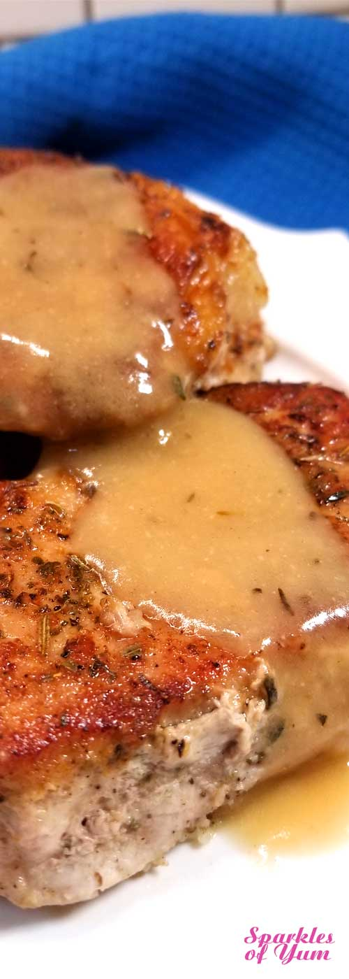 It only looks like we're getting fancy around here with these Pork Chops in Creamy Wine Sauce, but this dish is so quick and easy that anyone can make this incredibly delicious dinner in no time at all! #porkrecipe #datenight #winesauce