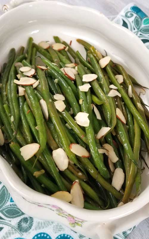 French Green Beans with Almonds Recipe - French Green Beans that are buttery and nutty, with a hint of lemon and garlic for some extra tasty goodness!