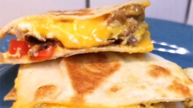Simple quick easy cheesy, a little bit crispy, and always yummy Breakfast Quesadillas are a nice change of pace for the breakfast table. Well I think they'd be good at lunch or dinner too!