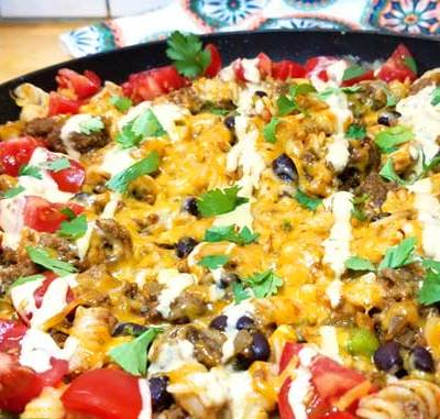 Delicioso, family friendly, quick dinner with easy clean up. This Tex-Mex Fiesta Skillet recipe checks all the boxes for the perfect weeknight meal in my book, and it's pretty too!