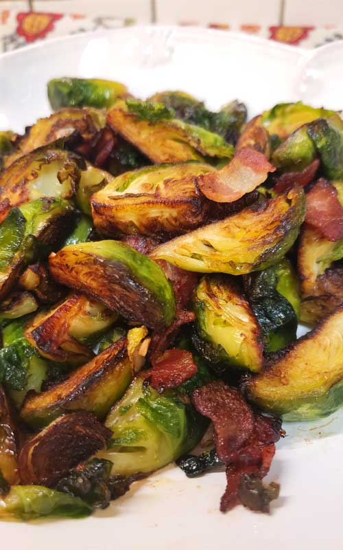 These Crispy Skillet Brussels Sprouts with Bacon & Garlic Butter are the absolute best Brussels sprout recipe! This is now one of my go-to recipes, easy to make and very delicious.