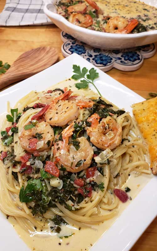 Need a super simple, quick, Chef's quality dinner for a busy day to serve your guests? You can have this Garlic Butter Tuscan Shrimp in Creamy Wine Sauce on the table in under 30 minutes and it's packed with my favorite Italian flavors!