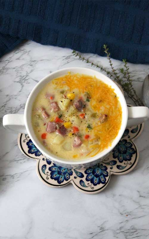 I love this cozy rich and creamy Ham and Potato Corn Chowder, it's so hearty and full of flavor. It just warms you up and puts a smile on your face.