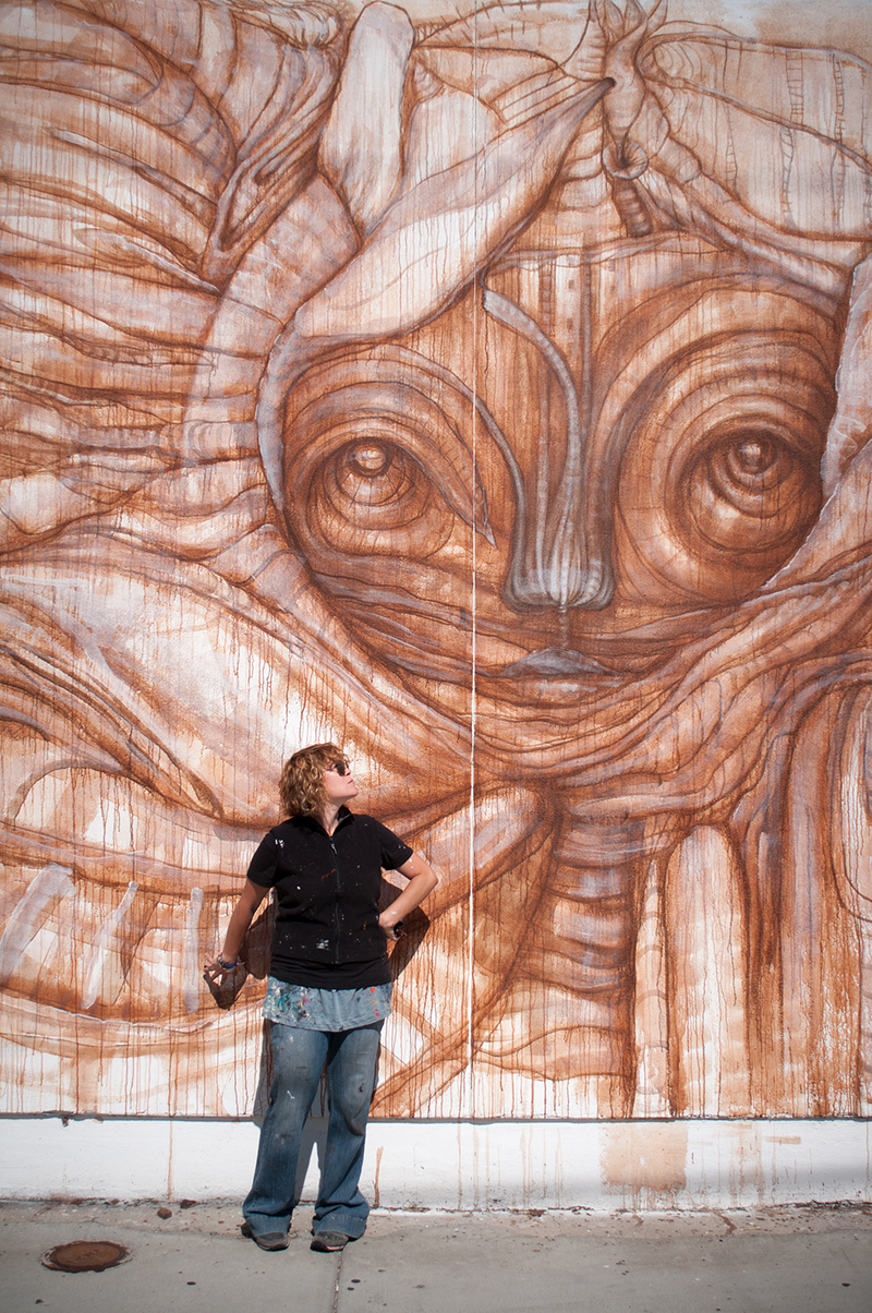 Gloria Muriel in front of mural at Bread and Salt, San Diego. Photo credit Alex H. Banach
