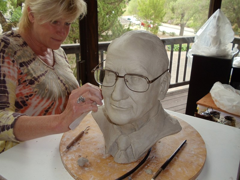 Julia S. Rasor sculpting bust of Ned S. Rasor