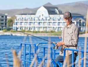 John Byrne/Tribune Jose Garcia enjoys some time fishing off the pier at the Sparks Marina last weekend.
