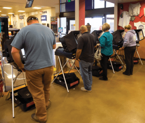 John Byrne/Tribune - Early Sparks voters cast their ballots at Raley's in Wingfield Springs on Monday.