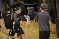 Penny Taylor and Diana Taurasi grab water during practice (By Bryce Patterson)