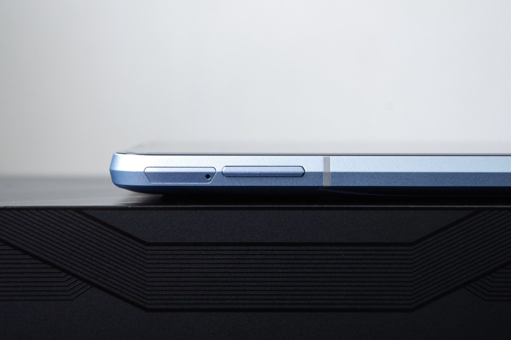 SIM card slot and volume keys on the left side of the unit