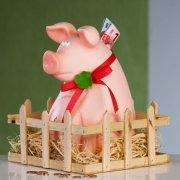 große Spardose Schwein mit roter Schleife