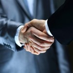closeup of businessmen shaking hand during negotiations