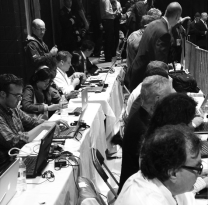The National pool of reporters traveling with Obama. They came in at the last second and got to sit at the tables with tablecloths and power strips. Us local folks did not get that despite having been there for hours. :/