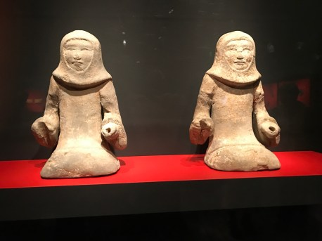 Pair of kneeling warrior figurines