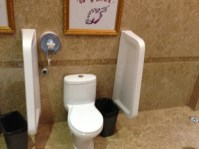 This is one of the small toilet bowls inside the women restrooms. As there was one child using one of the bowls, I could not take the full row of little toilet bowls which are vey clean and neat.