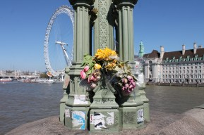Flowers catch the eye of tourists walking across the London bridge.