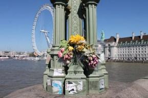 Flowers catch the eye of tourists walking across the London bridge.