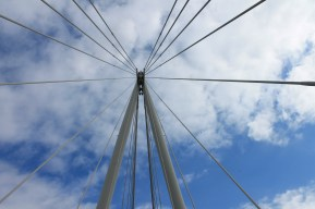 The bridge that connects Downtown London to other streets is decorated in long, white tubes.