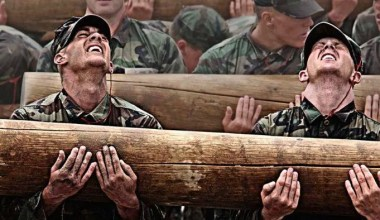 Navy SEALs during the BUD/s with a wood