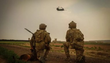 US Army Special Forces operators are observing landing of the chopper