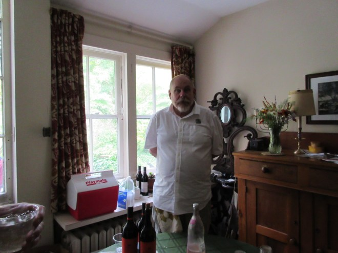 Friends of the NC Room Board Member/crostini maker/cheese slicer/bartender, Terry Taylor.