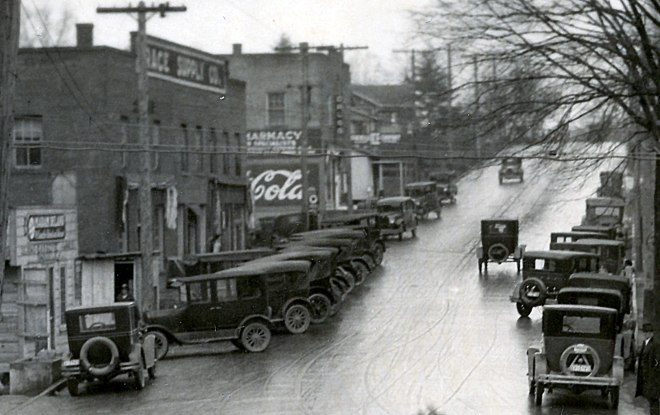 """Detail of the photo, tone-adjusted and sharpened, shows (l-r) Grace Supply Co., Grace Pharmacy (""""Drugs""""), and Asheville Ice Company depot. (click photo to enlarge)"""