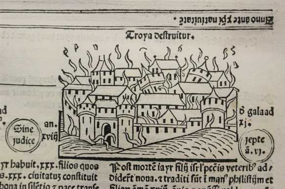 Deatil of a page of 'Fasciculus tempor[um]', featuring an illustration of a burning city