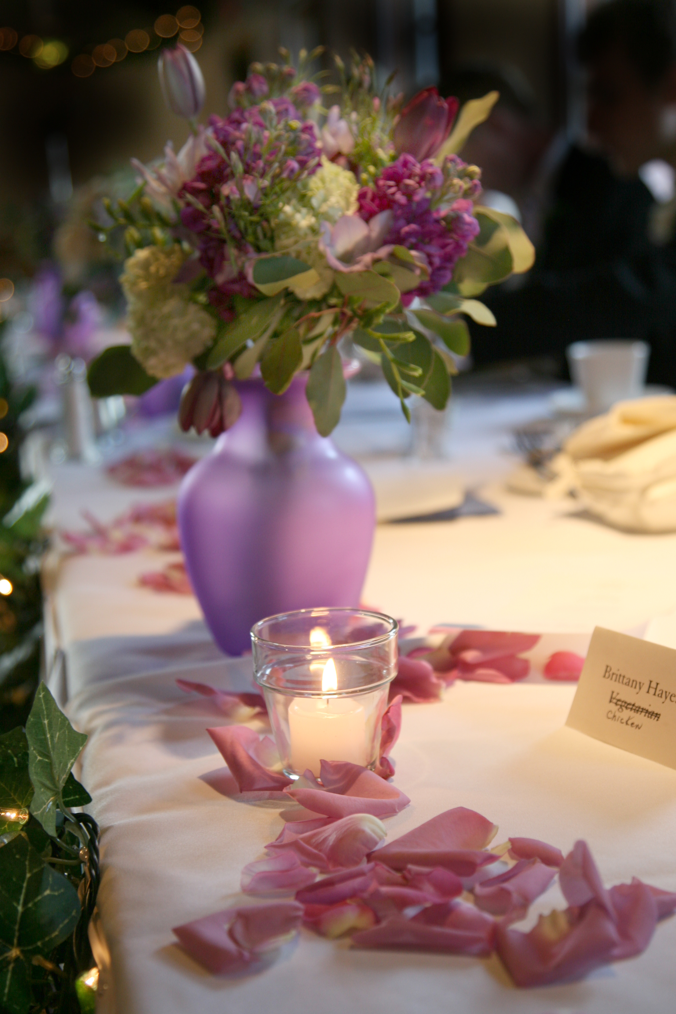 The head table with the bridesmaid bouquet