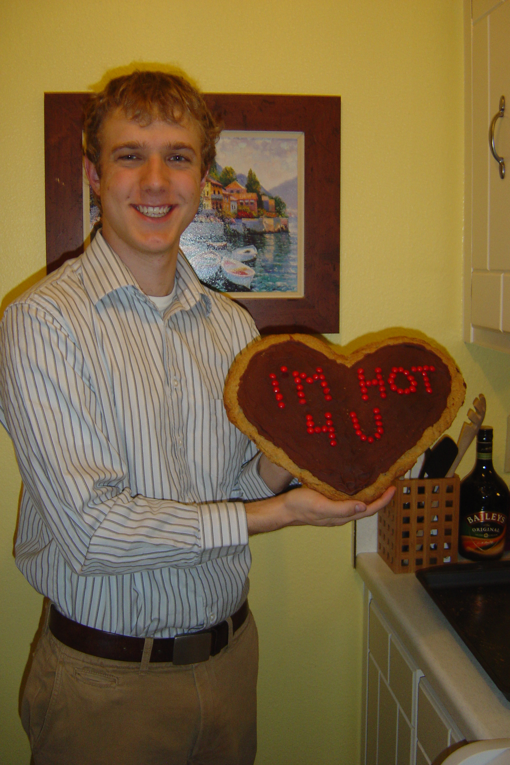 """Travis and his V-day present from me--a giant chocolate chip cookie that had """"I'm Hot For You"""" written in red hots"""