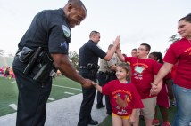 Athlete shaking hands w officer 3