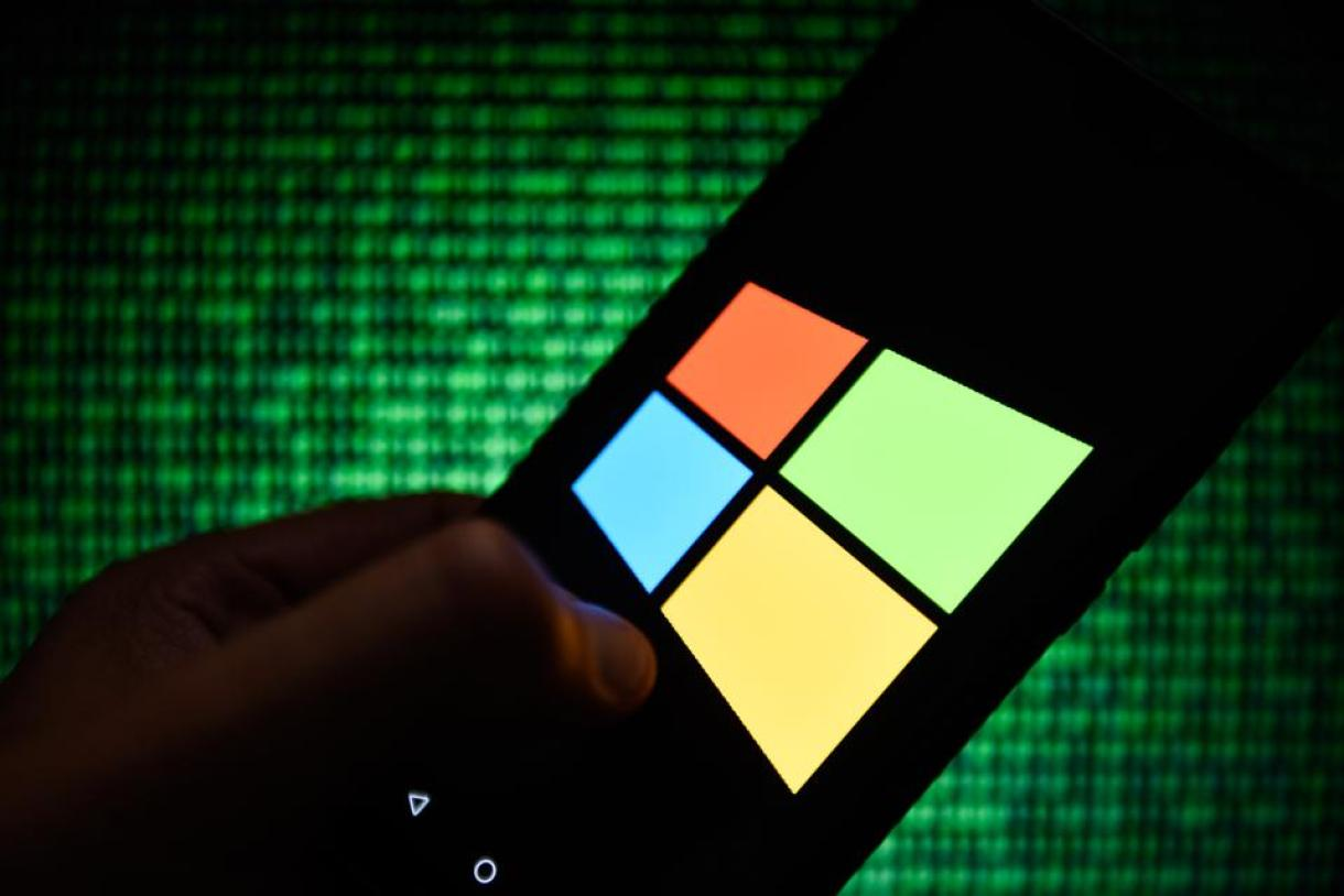 In this photo illustration a Windows operative system logo...