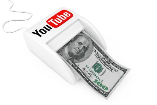 KIEV, UKRAINE - 17 mai: Gagnez de l'argent avec YouTube Concept. Machine YouTube Money Maker avec billets de banque en dollars. Rendu 3D