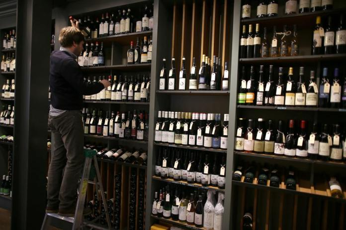 Michael Dupuy in his Boston wine shop on January 4, 2020 after launching an online petition to oppose the Trump administration's 100% tariff on European wine.