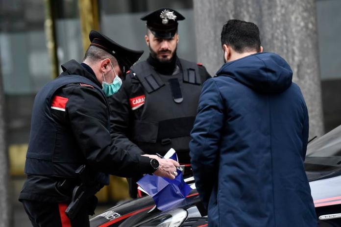Police check travel documents for pedestrian coronavirus pandemic in Italy