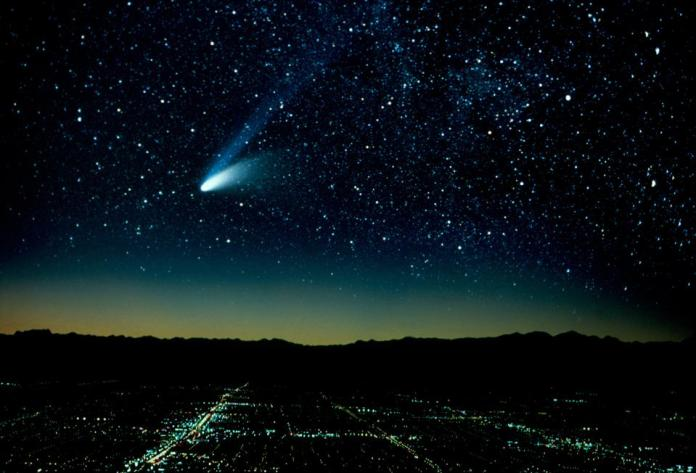 Comet Hale-Bopp and city at night