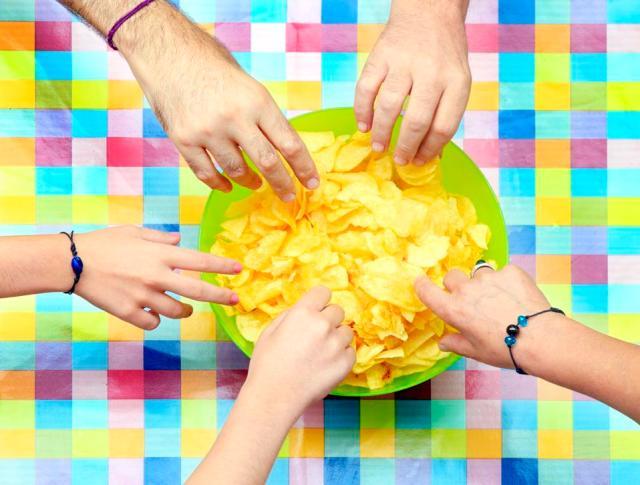 Sharing a bowl of potato chips