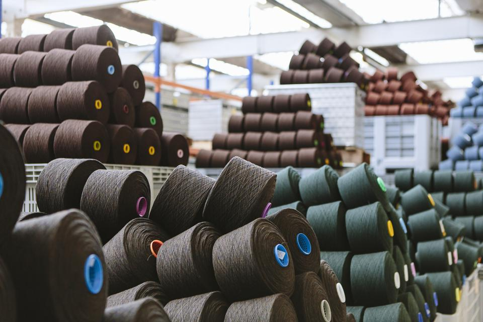 Reels of wool in storage room in woollen mill