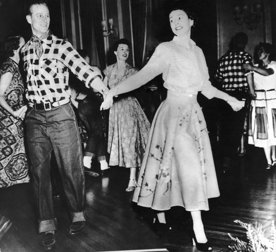 Queen Elizabeth and Prince Philip dance during a Royal Barn Dance 1951