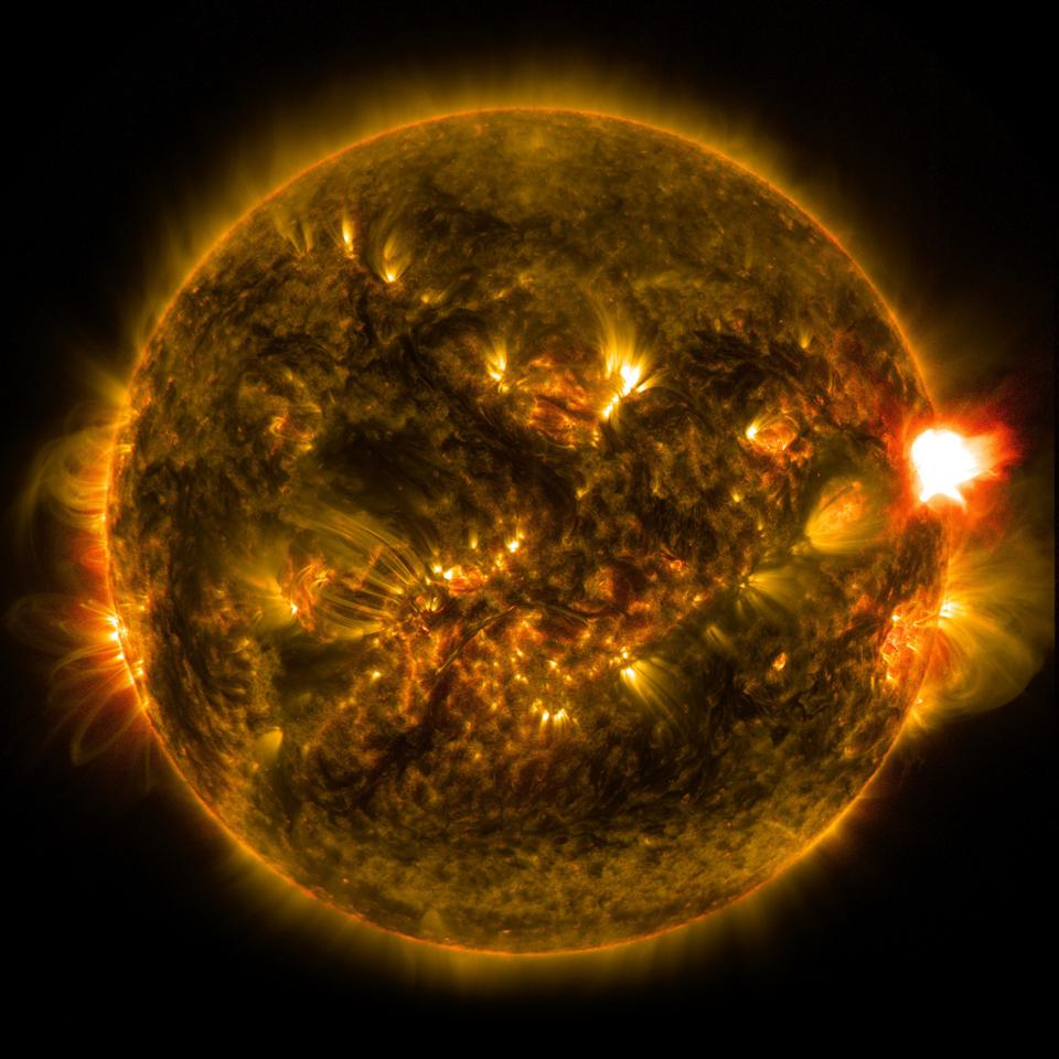 A solar flare, at right, occurs when magnetic field lines split apart and reconnect.