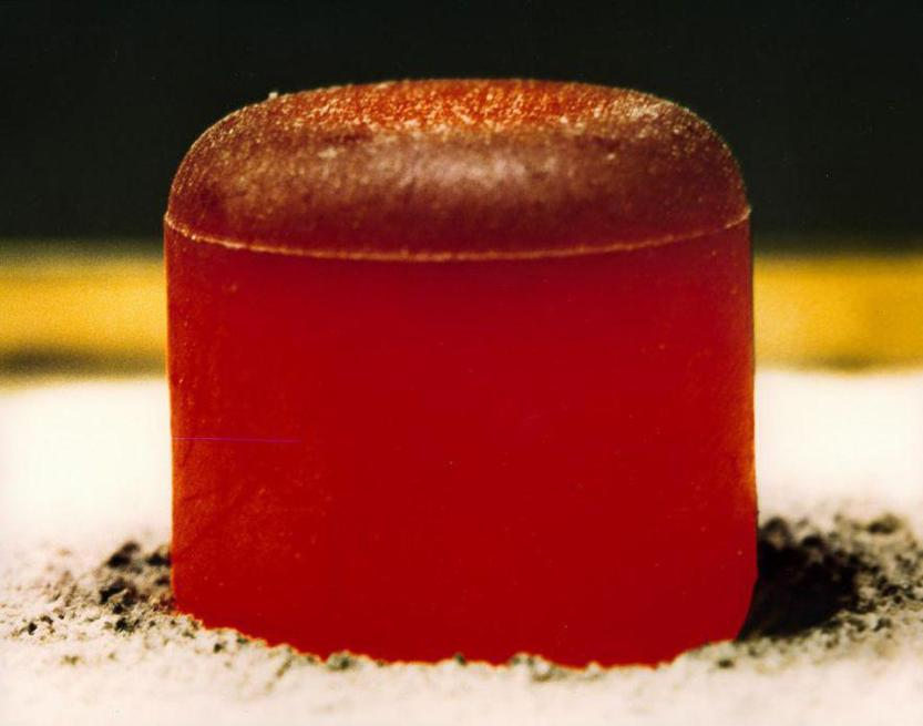 A pellet of Plutonium Oxide, which is warm to the touch and glows under its own power.