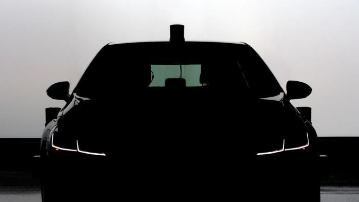 A battery-powered Volkswagen E-Golf that's part of Aurora's self-driving test fleet.