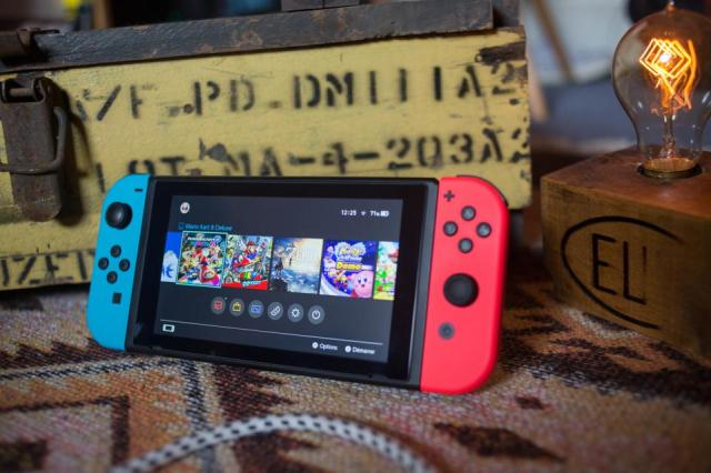 A turned on Nintendo Switch with two Joy-Con...