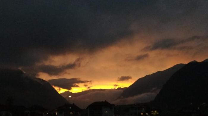 Yellow glowing sunset photographed on July 25, 2019 in the Alps.
