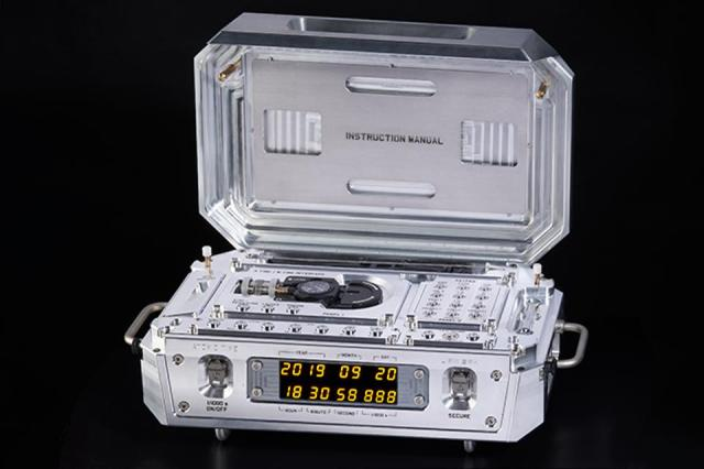 Urwerk AMC (Atomic Mechanical Control) with an atomic clock that connects to a titanium wristwatch. It sold for $2.9-million.