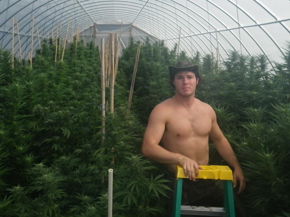 Me in my greenhouse circa 2014 full of 8' tall Pink Champagne full season plants
