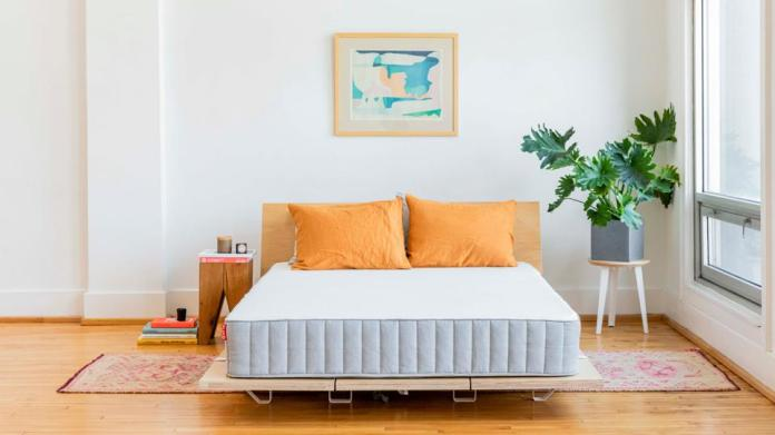 Floyd platform bed with orange pillows in a serene bedroom