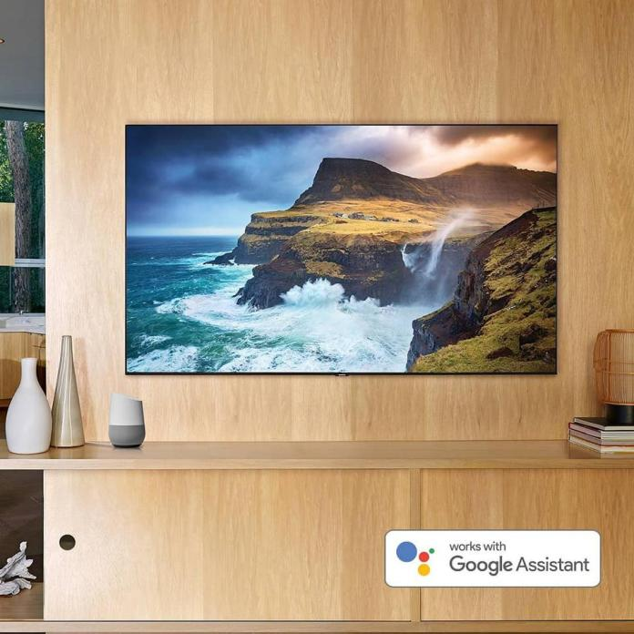 Wall-mounted flat screen TV shows a beautiful vivid landscape scene