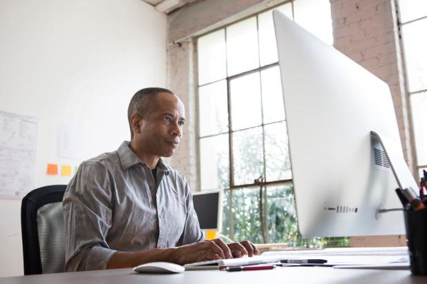 Blockchain: African American architect working in office
