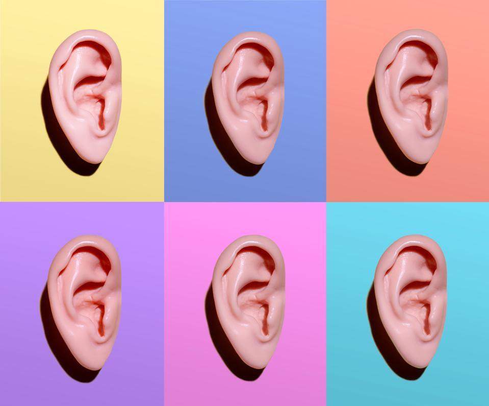 Human ears on different colors