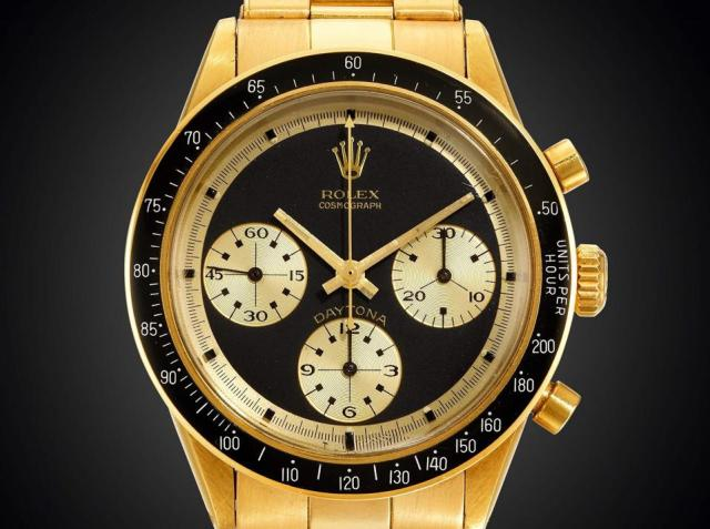 The Paul Newman dial of the Rolex Cosmograph Daytona JPS reference 6264 in 18k gold