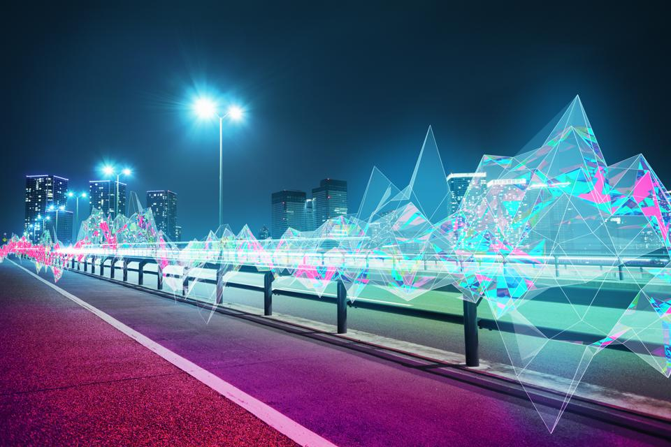 Cityscape with abstract light trail at night